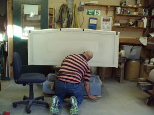 Don Collette preparing the headstone